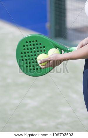 Girl Holding Paddle Balls