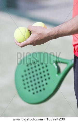 Man Holding Paddle Balls
