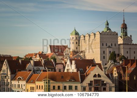 White castle and red roofs of residential houses in Szczecin, Poland