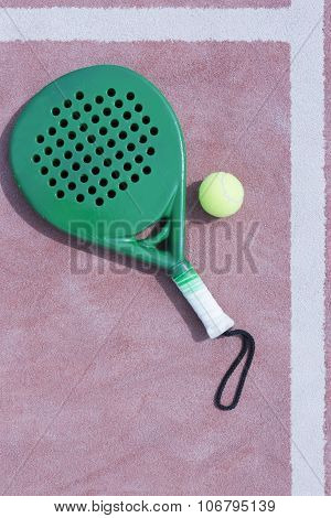 Paddle Racket And Ball In The Line.