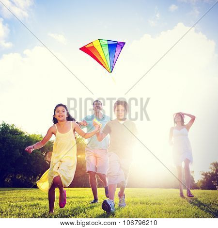 Family Flying Kite Together Outdoors Concept