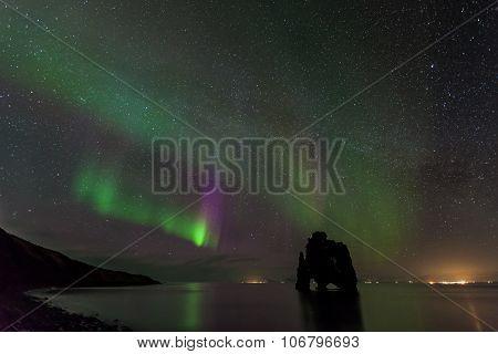 Beautiful Northern light at hvitserkur, Iceland.