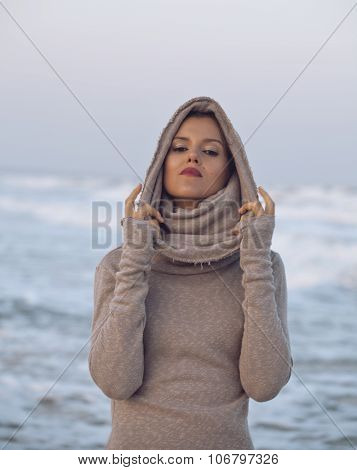 young pretty woman in sweater at seacoast walking relaxing