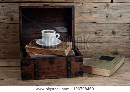 Cup Of Coffee On Old Books