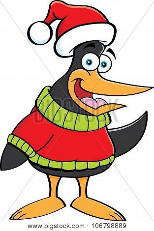 Cartoon penguin wearing a sweater and a Santa hat.