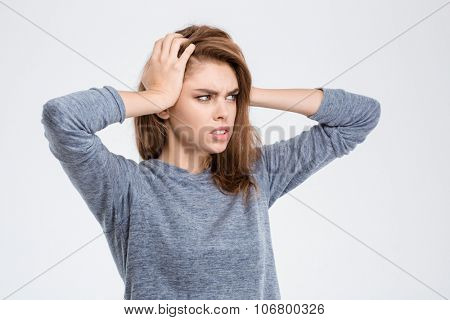 Portrait of a young woman having headache isolated on a white background