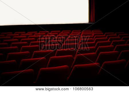 Red chairs in the cinema theater