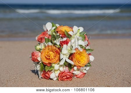 Bunch Of Flowers On A Tropical Beach