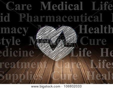 Health concept: Heart in grunge dark room
