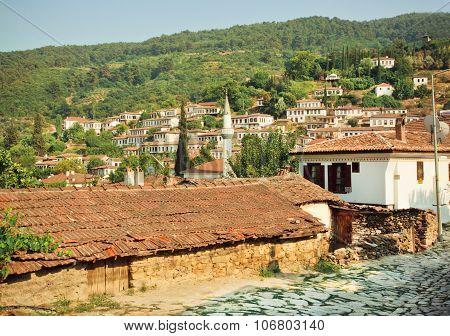 Village Landscape With Minaret And Tiled Roofs Of Turkey