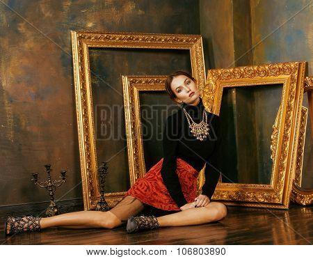 beauty rich brunette woman in luxury interior near empty frames, vintage elegance close up fashion