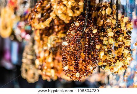 amber bracelets on market of antiques