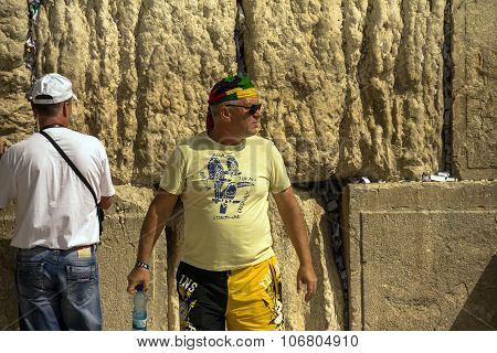 Unknown Tourist In Yellow  Shorts And A Bright Colored Bandana On His Head  At The Western Wall
