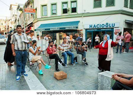 Woman Dancing Near The Street Musicians Playing Traditional Turkish Music Outdoor