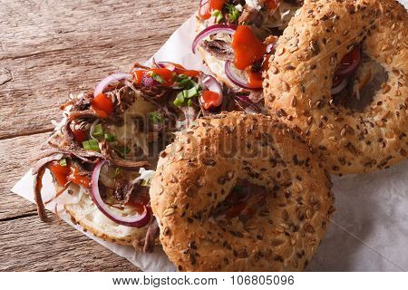 Bagels With Pulled Pork, Onions, Cabbage And Sauce Close-up