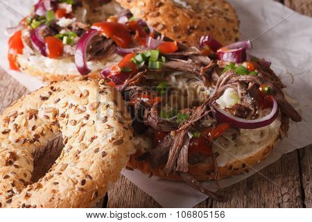 Bagels With Pulled Pork, Onions And Slaw Close-up. Horizontal