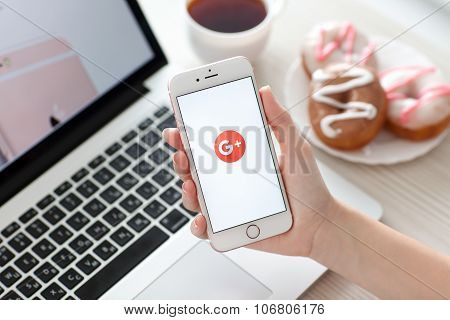 Woman Holding Iphone 6S Rose Gold With Google Plus