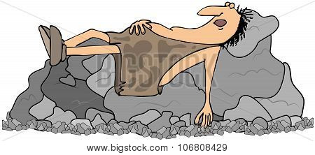 Caveman sleeping on some rocks