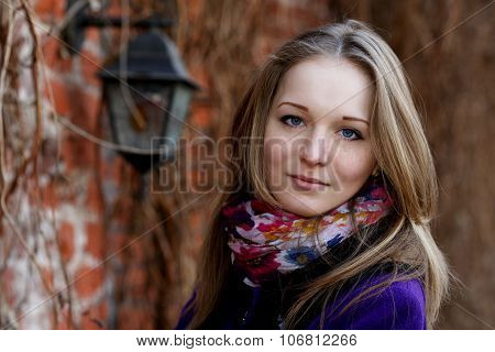Girl With Freckles On The Background Of The Cityscape