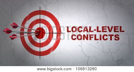 Politics concept: target and Local-level Conflicts on wall background