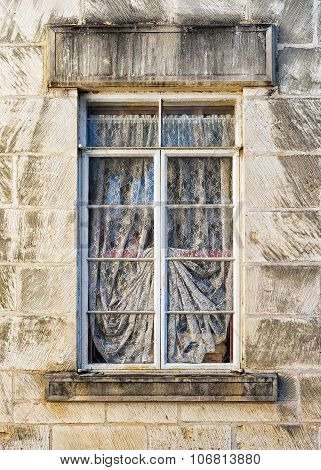 Weathered Window In A Limestone Wall