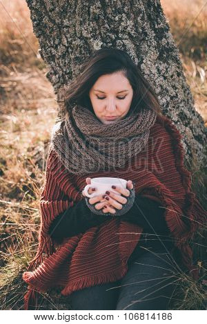 Woman In Nature Holding Cup