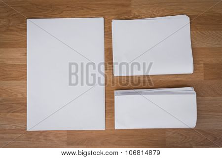 Blank Newspaper with empty space mock up on wood background