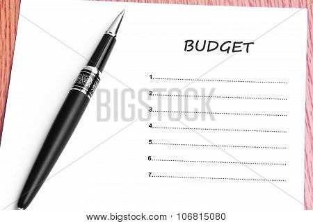 Pen  And Notes Paper With Budget List