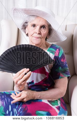 Active Female Senior With Fan In Her Hand