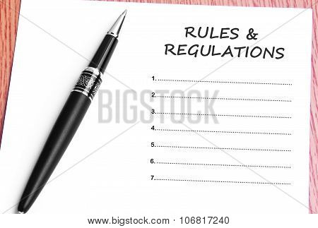 Pen  And Notes Paper With Rules & Regulations List