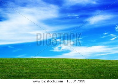 Horizon Over Green Field And Beautiful Blue Sky With Clouds