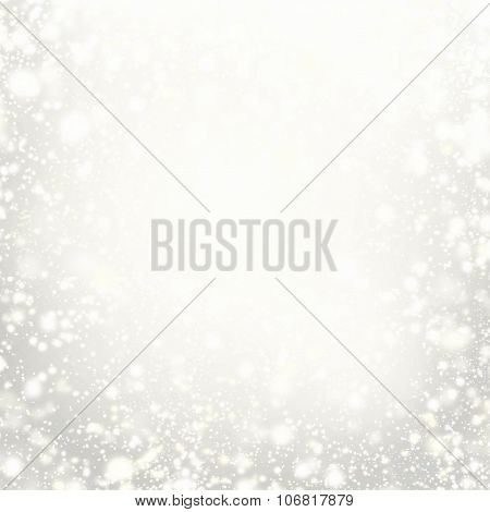 Beautiful Christmas Background With Silver Lights, Stars And Snowflakes. Abstract Festive Lights Whi