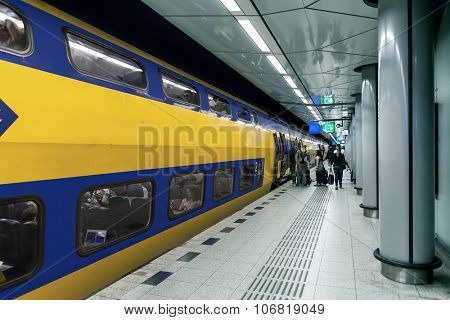 AMSTERDAM, NETHERLANDS - JULY 07, 2015: Train on train station in Amsterdam Airport Schiphol - main international airport of the Netherlands, fifth busiest in Europe, opened on 16 September 1916.