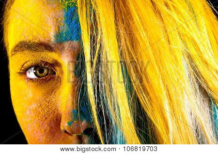 Beautiful Woman Covered With Yellow And Blue Paints