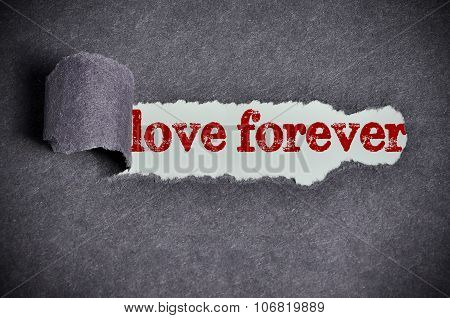 Love Forever Word Under Torn Black Sugar Paper