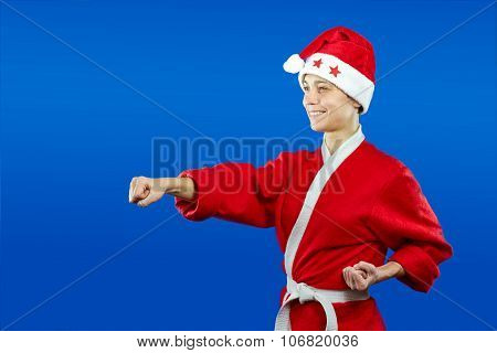 girl in dressed as Santa Claus beats punch hand