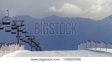Panoramic View On Snow Skiing Piste And Ropeway