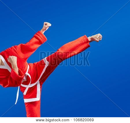 Karate blows and kicks in red Santa Claus clothes