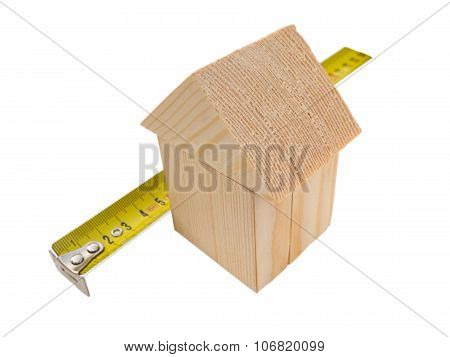 House Of Wooden Building Blocks With Ruler