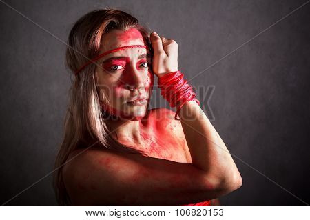 Beautiful Young Woman Covered With Red Paints