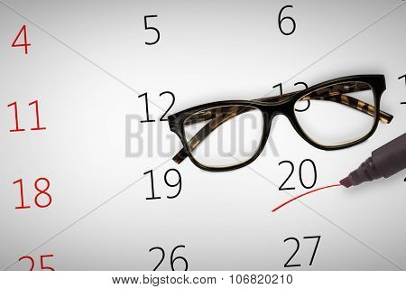 Reading glasses against black marker