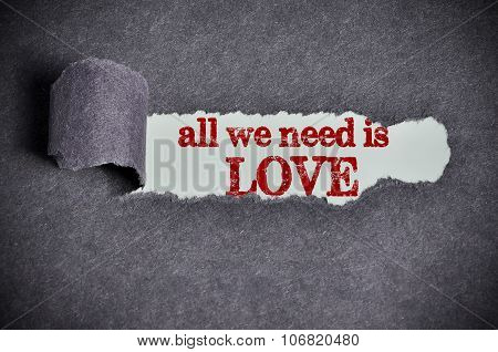 All We Need Is Love Word Under Torn Black Sugar Paper