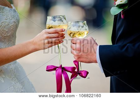 Glasses With Champagne In Hands Newlyweds