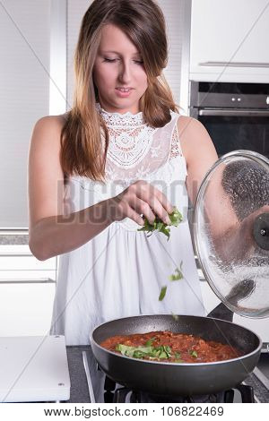 Young Woman Cooking Spaghetti Bolognese