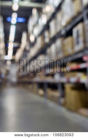 Blured rack storage warehouse interior background.
