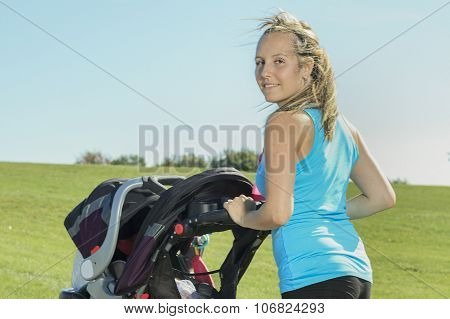 A mother training with baby on a summer day