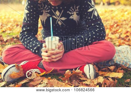 Man hands with cup of coffee, autumn outdoor relax.