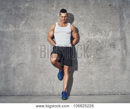 Muscular And Fit Man Relaxing After Workout