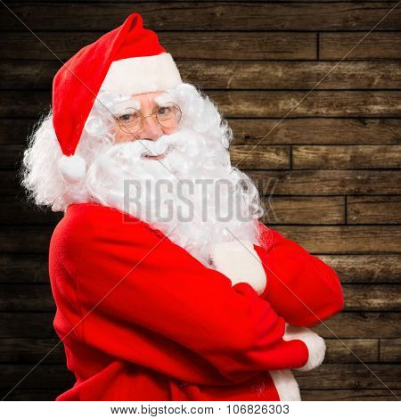 Santa Claus against a wooden background