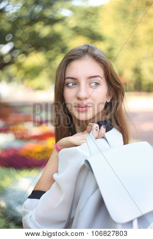 Young Student Girl With Bag Glanced Over Her Shoulder